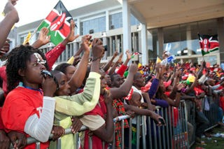 Supporters of Kenyan presidential candidate Uhuru Kenyatta celebrate at the Catholic University in Nairobi, where Uhuru Kenyatta gave the acceptance speech of his victory in Kenya's national elections on March 9, 2013.Jennifer Huxta/AFP/Getty Images