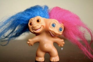 Illustration for article titled Satan cackles as new Trolls Dolls movie, TV show, video game and whatever humans can market moves forward