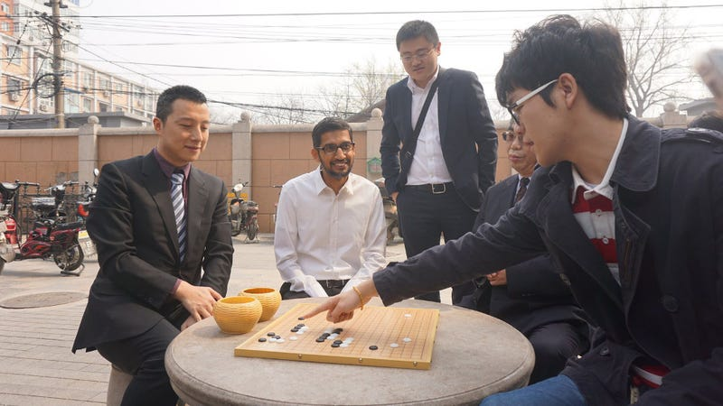Go champion Ke Jie (far right) recreating the opening moves of one of AlphaGo's games from last year. (Image: Deepmind)