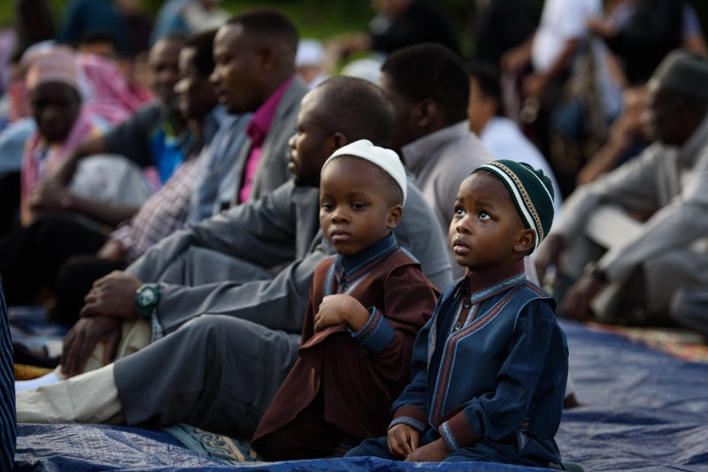 Young boys wait for the beginning of a prayer during an Eid al-Fitr celebration, which marks the end of Ramadan, on June 25, 2017, in Pittsburgh