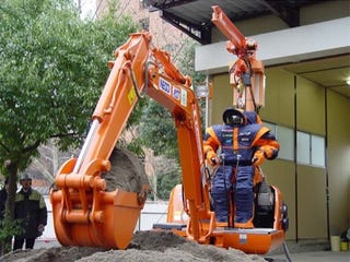 Illustration for article titled Human Drives Robot Dressed as Human Driving a Digger (Verdict: We Dig It)