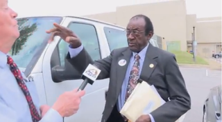 City Commissioner Amos Newsome in altercation with WTVY reporter Ken Curtis Oct. 6, 2015, in Dothan, Ala.WTVY