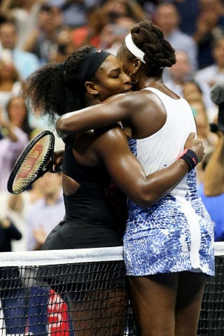 Serena Williams hugs Venus Williams after defeating her during their women's-singles quarterfinals match on day 9 of the 2015 U.S. Open at the USTA Billie Jean King National Tennis Center in New York City Sept. 8, 2015.Matthew Stockman/Getty Images
