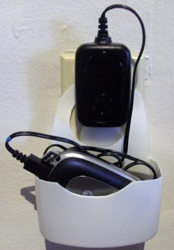 Illustration for article titled Outlet-Hanging Charge Station For Your Small Gadgets