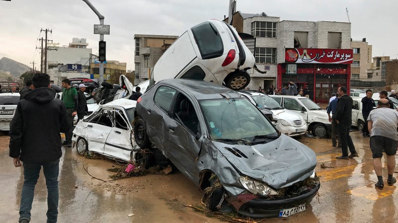 Floodwaters completely wrecked these vehicles Monday, March 26, 2019, in Shiraz, Iran.