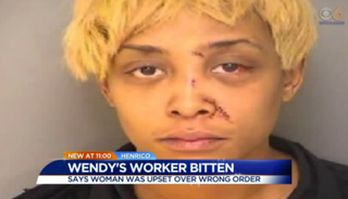 Lovely Robinson, charged with biting a Wendy's employee in Richmond, Va., on Feb. 15, 2016 WTVR