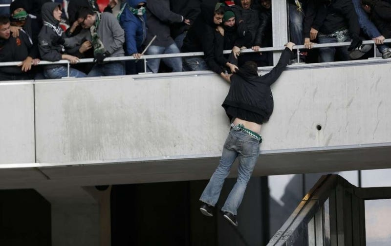 Illustration for article titled Photos: French Soccer Fans Brawl With Riot Police
