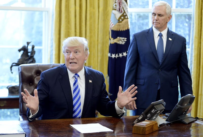 Donald Trump in the Oval Office on Friday showing how big the fish was that voted against his healthcare bill, completely destroying it singlehandedly (Photo by Olivier Douliery-Pool/Getty Images)
