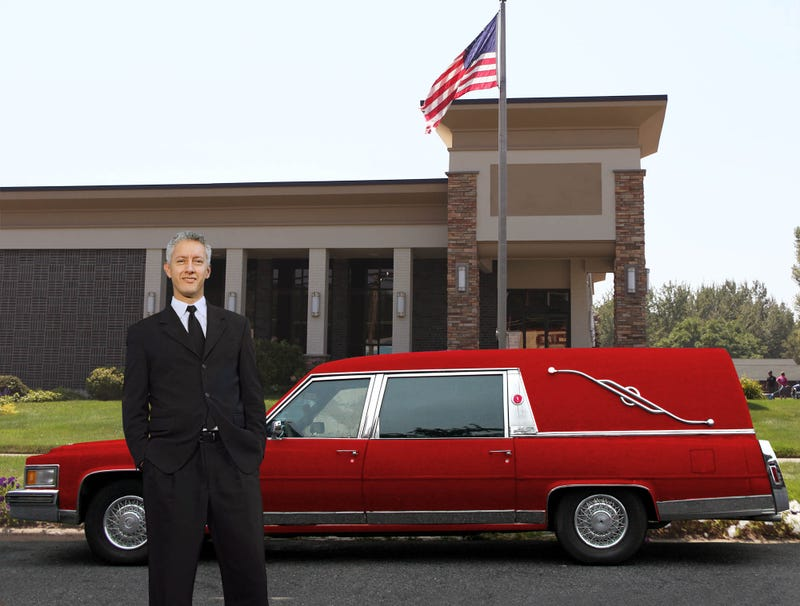 Illustration for article titled Middle-Aged Funeral Director Buys Flashy Red Hearse