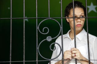 Heather Mack waits in a cell before her first hearing trial Jan. 14, 2015, in Denpasar, Bali, Indonesia. Heather Mack and her boyfriend, Tommy Schaefer, are accused of murdering Mack's mother, Sheila von Wiese-Mack, whose body was found stuffed inside a suitcase in the back of a taxi outside a luxury Bali hotel in August 2014. Agung Parameswara/Getty Images