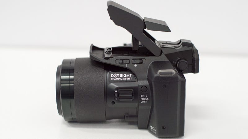 Illustration for article titled OLYMPUS SP-100 Is a 50X Superzoom Camera With a Red Dot Sight Like a Gun