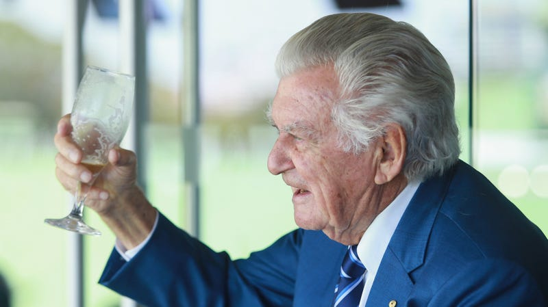 Former Australian Prime Minister Bob Hawke finishes a cold beer while watching a cricket match in 2018.