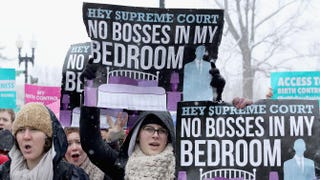 Demonstrators rally outside the U.S. Supreme Court March 25, 2014, during oral arguments in the Hobby Lobby case.Chip Somodevilla/Getty Images