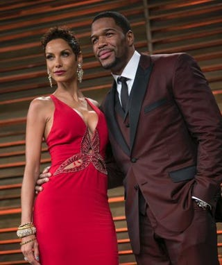 Michael Strahan and Nicole Murphy arrive at the 2014 Vanity Fair Oscar Party on March 2, 2014, in West Hollywood, Calif. ADRIAN SANCHEZ-GONZALEZ/AFP/Getty Images