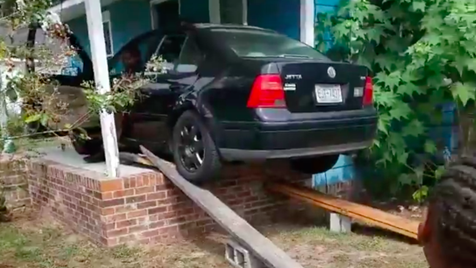 Watch A North Carolina Family Drive a VW Jetta Onto a Porch in Preparation for Hurricane Florence
