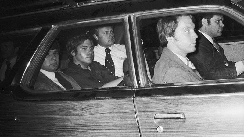 Hinckley being driven from U.S district court the day of his assassination attempt (Photo: John Full/Getty Images)