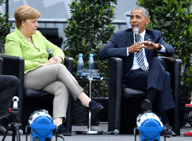 Former President Barack Obama and German Chancellor Angela Merkel at the Brandenburg Gate during the  Church Congress on May 25, 2017, in Berlin (Alexander Koerner/Getty Images)