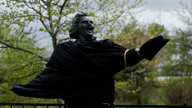 A partially covered statue of singer Kate Smith is seen near the Wells Fargo Center, Friday, April 19, 2019, in Philadelphia.