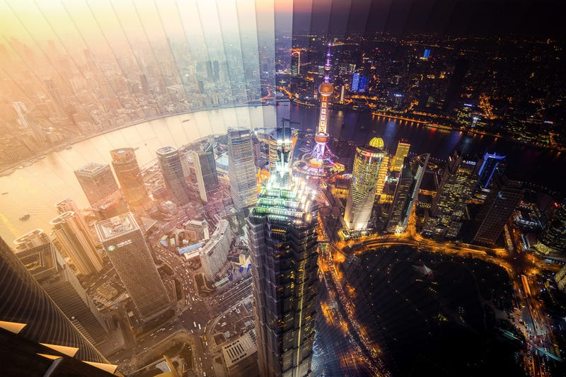 Illustration for article titled Stunning photographs capture day and night of Shanghai and Hong Kong