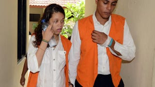 Heather Mack and Tommy Schaefer walk to a courtroom for a trial hearing in Bali, Indonesia, on March 11, 2015.SONNY TUMBELAKA/AFP/Getty Images