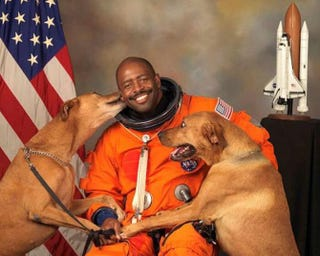 Retired NASA astronaut Leland Melvin's official photo features his two dogs, Jake and Scout.Twitter