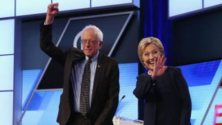 Democratic presidential candidates Bernie Sanders and Hillary Clinton wave to supporters before the Univision News and Washington Post Democratic presidential primary debate at Miami-Dade College in Miami on March 9, 2016.Joe Raedle/Getty Images