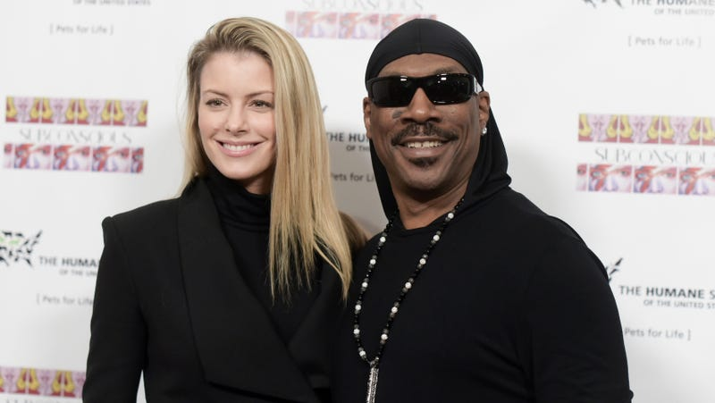 "Paige Butcher, left, and Eddie Murphy attend ""SUBCONSCIOUS"" by Bria Murphy Gallery Opening in Los Angeles on Nov. 20, 2016."