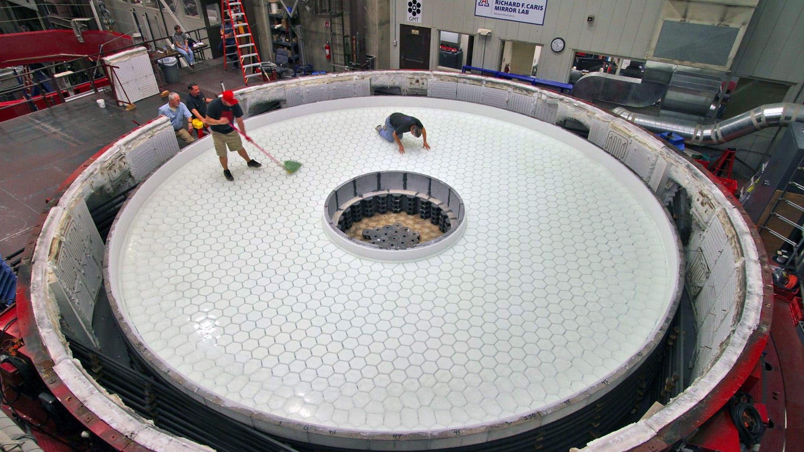 Inspecting A Giant Telescope Mirror Looks A Lot Like