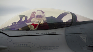 Illustration for article titled So this is how Santa Claus delivers all those presents (in a F-16!)