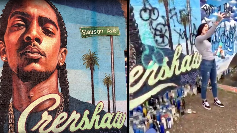 Illustration for article titled White Woman Defaces Nipsey Hussle Memorial