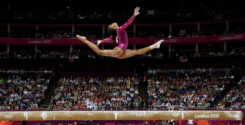 Illustration for article titled Gabby Douglas's Beam Performance Gives Us The Defining Photo Of The London Olympics