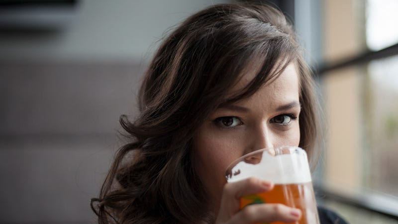 Illustration for article titled Just holding a beer makes women appear less human, study finds