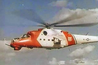 Illustration for article titled Why Is This Mi-24 Hind Wearing U.S. Coast Guard Colors?