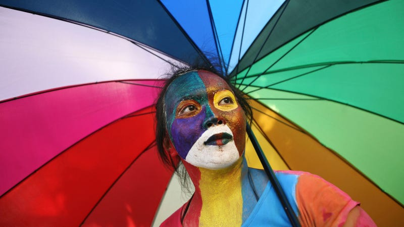 An activist at a protest demanding equality for LGBTIQ people in Medan, North Sumatra, Indonesia (Image via AP)