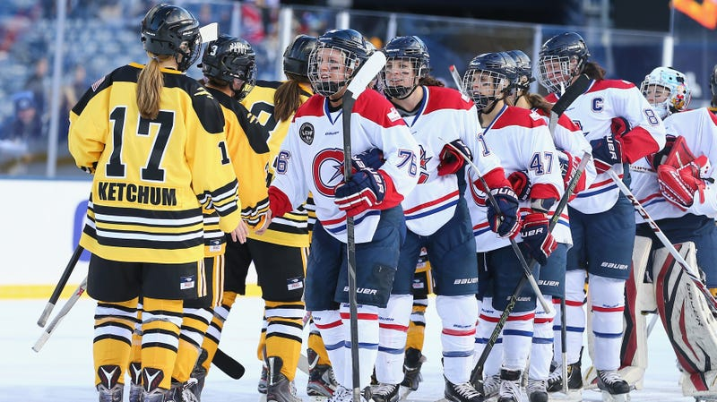 Players from the Boston Pride (NWHL) and the Les Canadiennes (CWHL) shake hands following the Outdoor Womens Classic at Gillette Stadium on December 31, 2015 in Foxboro, Massachusetts.
