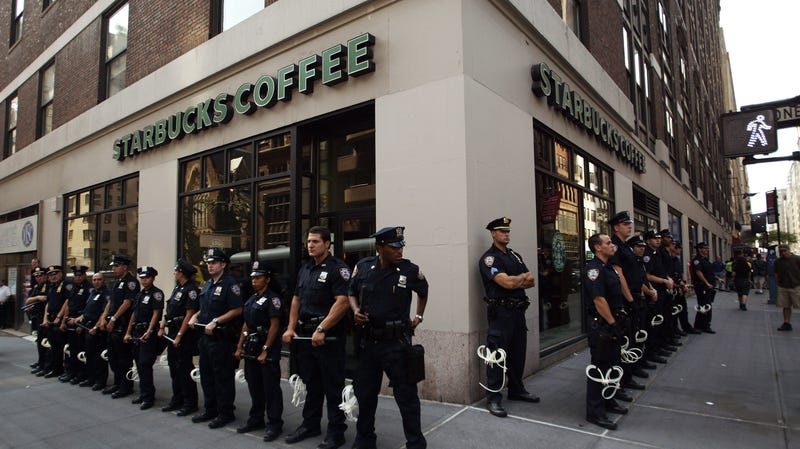 Police line up in front of a Starbucks coffee shop on Aug. 28, 2004, in New York City.