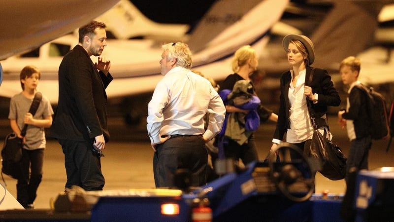 Elon Musk, a man I presume to be a pilot, and Amber Heard. Image via Backgrid.