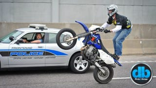 Illustration for article titled Bikers overwhelm local cops with highway stunt show