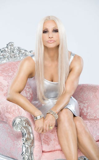 Illustration for article titled OMG Gina Gershon Looks Faaaaaabulous as Donatella Versace