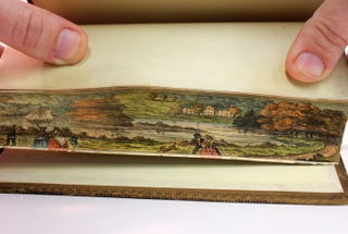 Illustration for article titled Fore-Edge Paintings: The Secret Works of Art Hidden Inside Book Pages
