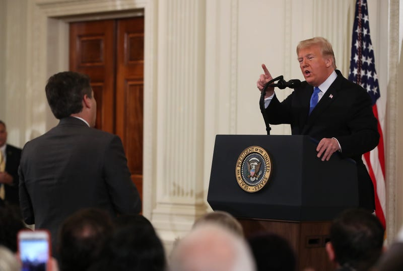 President Donald Trump answers a question from Jim Acosta of CNN after giving remarks a day after the midterm elections on November 7, 2018 in the East Room of the White House in Washington, DC.