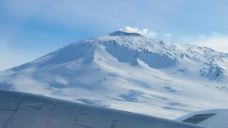 Unlike Antarctic volcano Mount Erebus (pictured), all of the newly identified volcanoes lie hidden beneath the continental ice sheet. (Image: NASA/Jim Yungel)