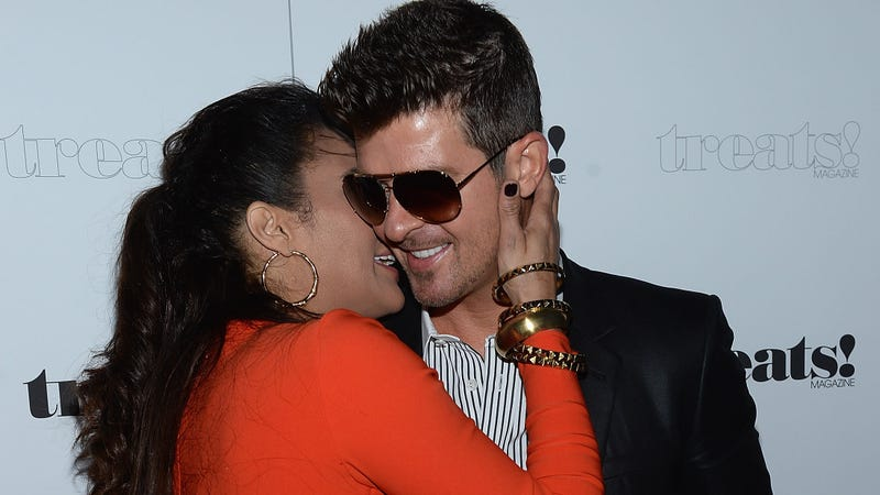 Illustration for article titled Robin Thicke Says He'd Be Dead without Paula Patton's Love