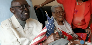 Duranord Veillard celebrates his 108th birthday Feb. 28, 2015. His wife of 82 years, Jeanne, seated next to him, is 104.USA Today screenshot