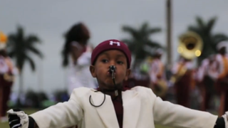 Drum major Taranza McKelvin leads the battle of the bands at the Muck Bowl.Screenshot from Palmbeachpost.com