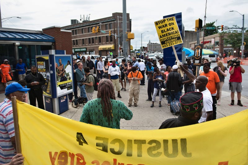 Activists speak out near the area in Baltimore where riots broke out in 2015 after the funeral for Freddie Gray. Their actions came the same day, June 23, 2016, that Baltimore Police Officer Caesar Goodson Jr., who faced the most serious charges in Gray's death, was acquitted.BRENDAN SMIALOWSKI/AFP/Getty Images