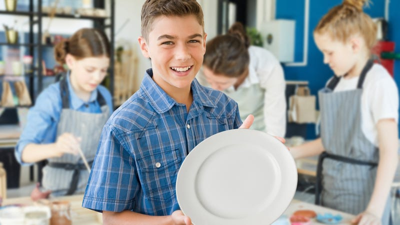 Illustration for article titled Definitely A Psychopath: This Kid Just Chose To Paint A Regular White Plate At His Friend's Ceramic Painting Party