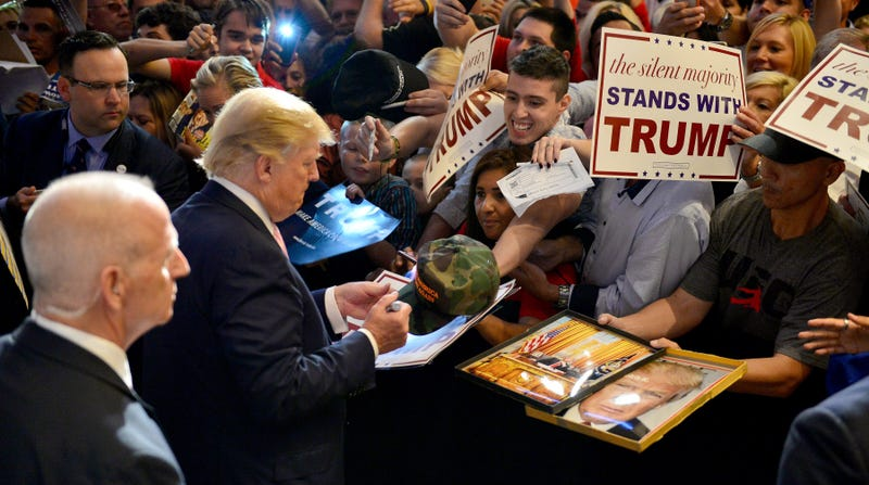 Donald Trump signing a camo hat that's now on eBay on October 23, 2015 in Doral, Florida (Getty Images)