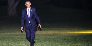 President Barack Obama returns from fundraisers in New York City. (Pool/Getty Images News)