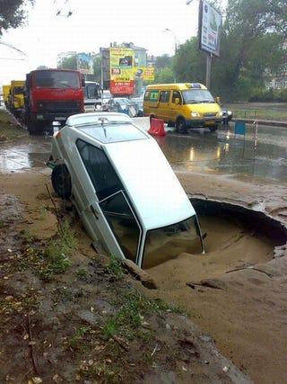 Illustration for article titled Quicksand Plus Pothole Equals Sunken Car